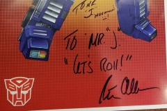 Transformers (Autographed Optimus Prime poster by voice actor Peter Cullen)